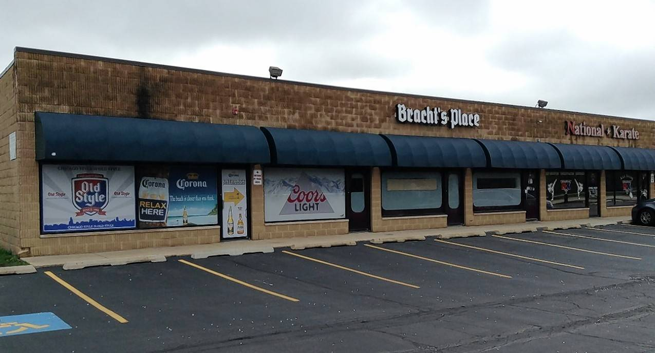 The owner of Bracht's Place, Bartlett's oldest bar, has received permission to allow drinkers to access his newly acquired space at the end of the strip mall he's occupied since 1990, as well as for construction of a fenced beer garden area behind it.