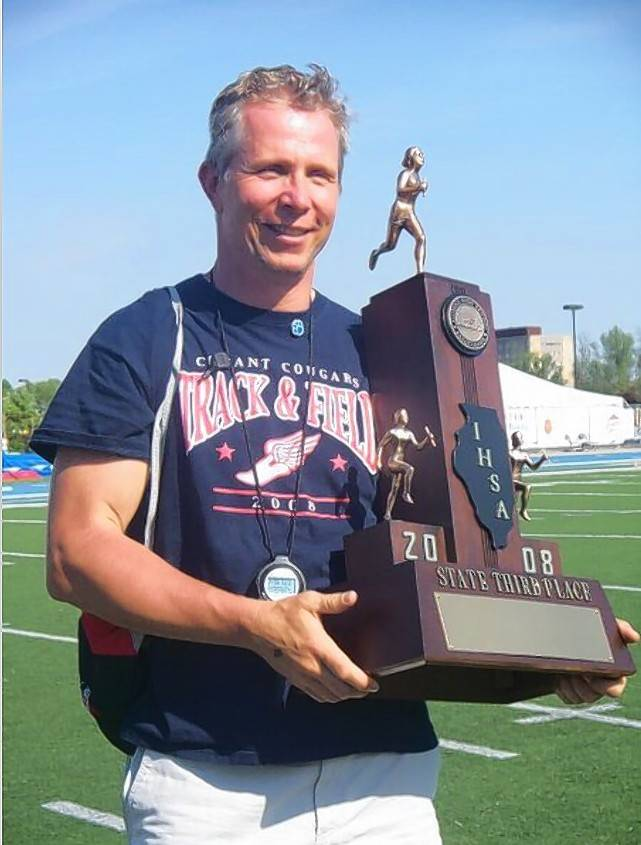 Bob Borczak, here with the third-place state trophy from 2008, is in the stretch run of a standout coaching career in track and field at Conant.