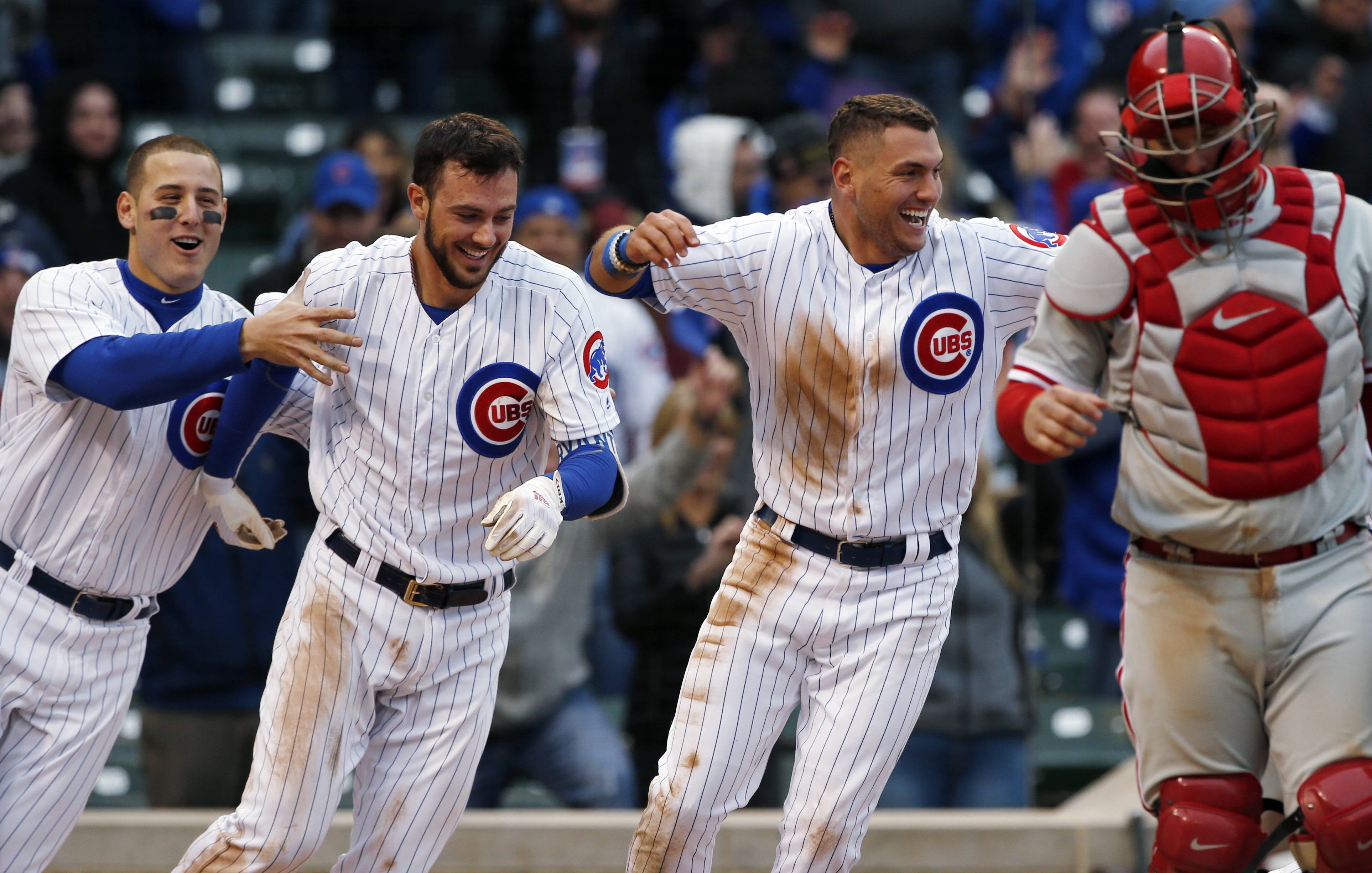 Anthony Rizzo, left, Kris Bryant, center, and Albert Almora Jr., celebrate after the Cubs defeated the Philadelphia Phillies. Almora Jr. was in the middle of more baserunning plays again Thursday. He doubled to lead off the bottom of the 13th inning and scored the winning run on a throwing error and the Cubs won 5-4.