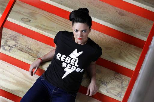 "In this March 16, 2017, photo, singer and songwriter Angaleena Presley poses in Nashville, Tenn. With her new solo album, ""Wrangled,"" Presley follows a wave of outlaw female artists in Nashville, including Nikki Lane, Margo Price and Sunny Sweeney who have built their own brands from the ground up and attracted a more diverse crowd of fans without the help of major label marketing budgets and country radio. (AP Photo/Mark Humphrey)"