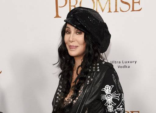 "FILE - In this April 12, 2017 file photo, Cher arrives at the premiere of ""The Promise"" in Los Angeles. Cher will sing her late 1990s anthem ""Believe� at the Billboard Music Awards this month. Dick Clark Productions announced Thursday, May 4, that Cher will also receive the ICON Award at the May 21 event in Las Vegas. (Photo by Chris Pizzello/Invision/AP, File)"