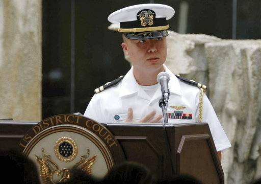In this Dec. 3, 2008, photo released by the U.S. Navy, Lt. Edward Lin, a native of Taiwan, speaks in the U.S. The U.S. military has charged Lin with espionage for allegedly passing military secrets to China or Taiwan. Lt. Cmdr. Stephanie Turo, a Navy spokeswoman, confirmed on Wednesday, May 3, 2017, the espionage trial in Norfolk will begin Thursday. (Sarah Murphy/U.S. Navy via AP)
