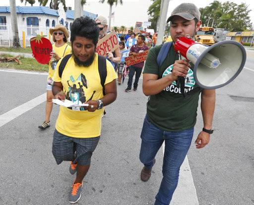 In this Monday, May 1, 2017 photo, Jose Luis Santiago, left, an immigration advocate, marches during a protest march in Homestead, Fla. Cinco de May, a once-obscure holiday marking a 19th Century-battle between Mexico and invading French forces, is being met with ambivalence by Mexican-American and Mexican immigrants. President Donald Trump's immigration policies and rhetoric are leaving some Mexican Americans and immigrants feeling at odds with Cinco de Mayo. (AP Photo/Wilfredo Lee)