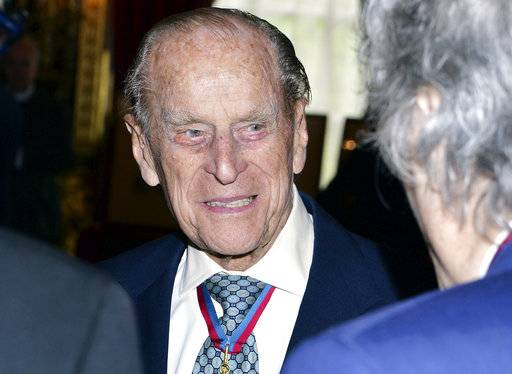 Britain's Prince Philip, the Duke of Edinburgh speaks to guests after attending the Order of Merit service at Chapel Royal in St James's Palace, London, Thursday May 4, 2017. Prince Philip, the consort known for his constant support of his wife Queen Elizabeth II as well as for his occasional gaffes, will retire from royal duties this fall, Buckingham Palace said Thursday. (John Stillwell/Pool Photo via AP)