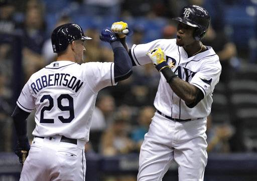 Tampa Bay Rays' Tim Beckham, right, celebrates his two-run home run off Miami Marlins pitcher Dan Straily with Daniel Robertson during the second inning of a baseball game Thursday, May 4, 2017, in St. Petersburg, Fla. (AP Photo/Chris O'Meara)