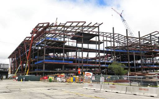 Construction continues work on the new NBA arena in Milwaukee on Tuesday, May 2, 2017. Crews reached a milestone Tuesday by placing the first of nine enormous roof trusses above the partially-finished steel structure. (AP Photo/Gretchen Ehlke)