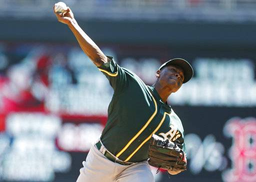 Oakland Athletics pitcher Jharel Cotton throws against the Minnesota Twins in the first inning of a baseball game Thursday, May 4, 2017, in Minneapolis. (AP Photo/Jim Mone)