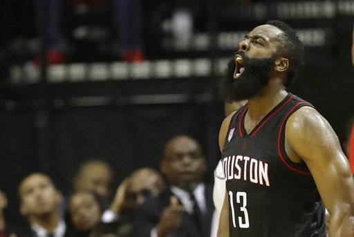 FILE - In this April 16, 2017, file photo, Houston Rockets' James Harden yells after a Oklahoma City Thunder turnover during the second half in Game 1 of an NBA basketball first-round playoff series in Houston. Harden is one tough player to guard. Crowd him and he drives by. Back off and he hoists a 3. And, always, he draws fouls. (AP Photo/David J. Phillip, File)