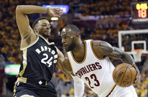 Cleveland Cavaliers' LeBron James (23) drives against Toronto Raptors' Norman Powell (24) duringd s* the first half in Game 2 of a second-round NBA basketball playoff series, Wednesday, May 3, 2017, in Cleveland. The Cavaliers won 125-103. (AP Photo/Tony Dejak)