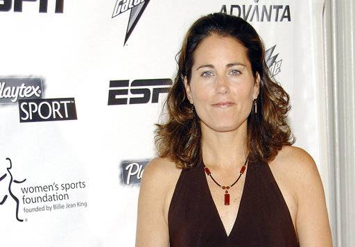 FILE - In this Oct. 15, 2007, file photo, soccer star Julie Foudy arrives at the Women's Sports Foundation's 28th Annual Salute to Women in Sports at the Waldorf-Astoria Hotel in New York. Foudy has signed a multiyear extension with ESPN and will focus on soccer, the Olympics and the NCAA championships. (AP Photo/Evan Agostini, File)