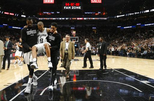 San Antonio Spurs guard Tony Parker (9) is carried off the court after being injured during the second half of Game 2 of a second-round NBA basketball playoff series against the Houston Rockets, Wednesday, May 3, 2017, in San Antonio. (Karen Warren/Houston Chronicle via AP)