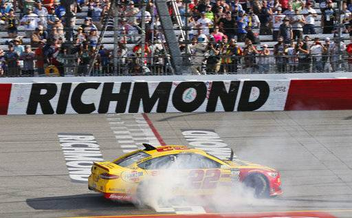 Joey Logano does a burnout as he celebrates after winning the NASCAR Cup Series auto race at Richmond International Raceway in Richmond, Va., Sunday, April 30, 2017. (AP Photo/Steve Helber)