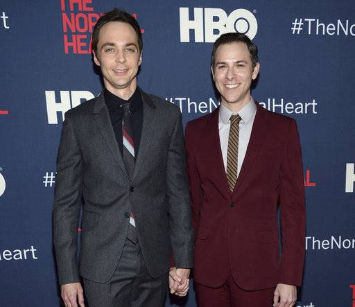 "FILE - In this May 12, 2014, file photo, Jim Parsons, left, and Todd Spiewak arrive at the NY Premiere of ""The Normal Heart"" in New York. Parsons' publicist confirmed multiple reports on May 15, 2017, that Parsons and Spiewak had married. (Photo by Evan Agostini/Invision/AP, File)"