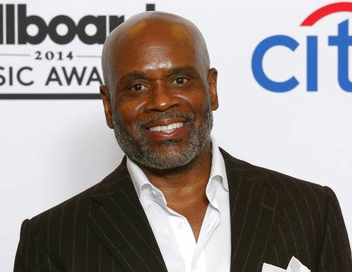 "FILE - In this May 18, 2014 file photo, L.A. Reid poses in the press room at the Billboard Music Awards in Las Vegas. After spending six years at Sony's Epic Records, Reid is no longer leading the label. Sony Music Entertainment released a seven-word statement Saturday, May 13, 2017, announcing the exit: ""L.A. Reid will be leaving the company.� The label had no additional comment. (Photo by Eric Jamison/Invision/AP, File)"