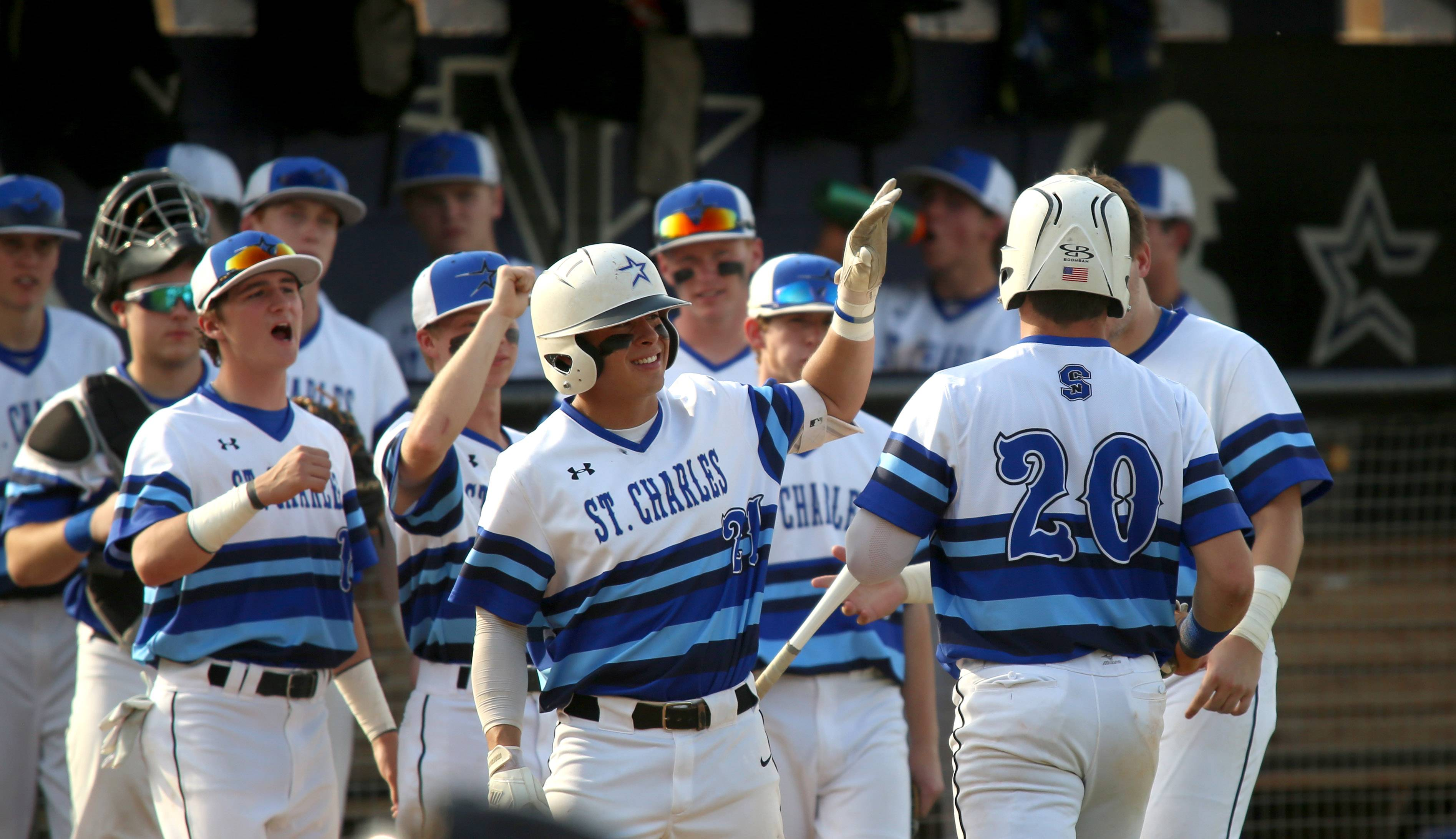 The St. Charles North Stars react after Tyler Mettetal scores against St. Charles East during varsity baseball at St. Charles North Monday evening.