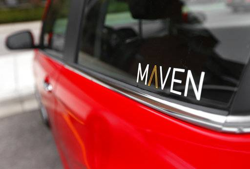FILE - This April 27, 2016, file photo, shows the Maven logo on a General Motors car-sharing service automobile, in Ann Arbor, Mich. General Motors Co. launched its Maven car-sharing service in New York on Monday, May 15, 2017. The service lets members rent a variety of GM vehicles for whatever they need, from a 30-minute errand to a 28-day road trip. (AP Photo/Paul Sancya, File)