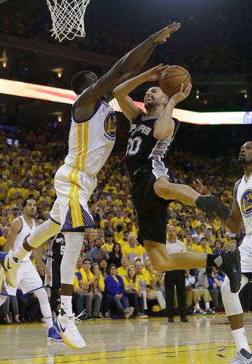 San Antonio Spurs guard Manu Ginobili (20) shoots against Golden State Warriors forward Draymond Green (23) during the second half of Game 1 of the NBA basketball Western Conference finals in Oakland, Calif., Sunday, May 14, 2017. The Warriors won 113-111. (AP Photo/Jeff Chiu)