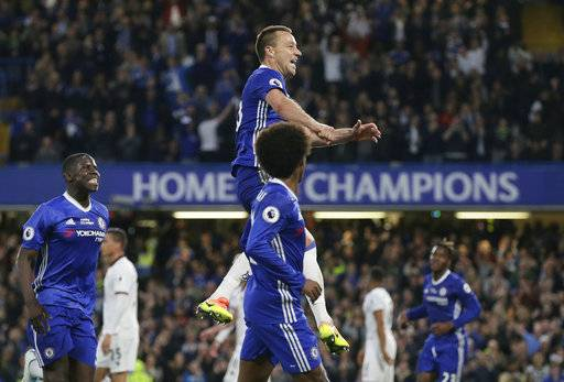 Chelsea's John Terry, centre, celebrates scoring a goal during the English Premier League soccer match between Chelsea and Watford at Stamford Bridge stadium in London, Monday, May 15, 2017. (AP Photo/Tim Ireland)
