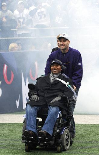 FILE - In this Feb. 5, 2013, file photo, O.J. Brigance, front, attends a celebration in Baltimore of the NFL football team's Super Bowl victory. Brigance will hold a celebration Tuesday, May 16, on the 10th anniversary of a day that forever changed his life. On May 16, 2007, the former Ravens linebacker learned he was afflicted with amyotrophic lateral sclerosis. There is no known cure for what is commonly known as Lou Gehrig's disease, and the life expectancy after being diagnosed is usually two to five years. Only 10 percent of those with ALS live 10 years beyond the diagnosis, which explains why Brigance and his wife, Chanda, intend to savor the moment. Brigance serves as senior adviser to player engagement for the Ravens, a job he started in 2004. In addition to assisting players in each phase of their career, Brigance is a source of motivation. (AP Photo/Steve Ruark, File)