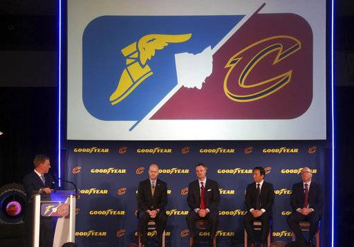 A press conference takes place with a logo overhead announcing a new partnership with Goodyear Tires and the Cleveland Cavaliers in Cleveland, Monday, May 15, 2017. Linked by geography and superstar LeBron James, the defending NBA champions announced a multiyear corporate sponsorship deal with Goodyear that includes the Cavs wearing the tire giant's winged-foot logo on the fronts of their jerseys starting next season. (Joshua Gunter/Cleveland.com via AP)