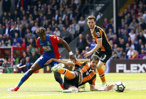 Crystal Palace's Wilfried Zaha, left and Hull City's Andrea Ranocchia battle for the ball during the English Premier League soccer match between Crystal Palace and Hull City, at Selhurst Park, London, Sunday May 14, 2017. (Paul Harding/PA via AP)