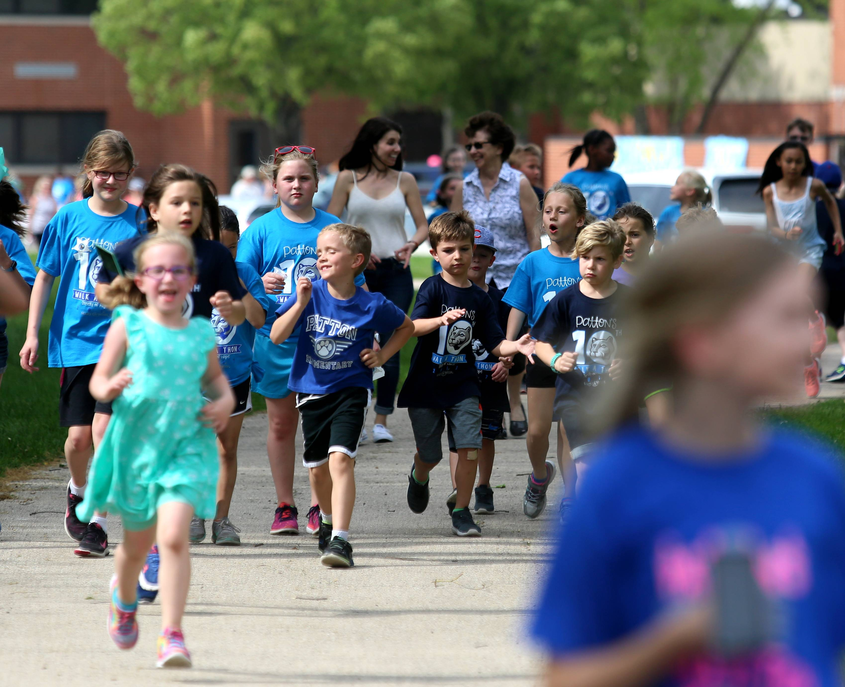 Students at Patton Elementary School in Arlington Heights take part in the school's 10th annual Make-A-Wish Foundation Walk-A-Thon Wednesday. The school has been inducted into the organization's Society of Hope for raising more than $100,000 over the last decade.