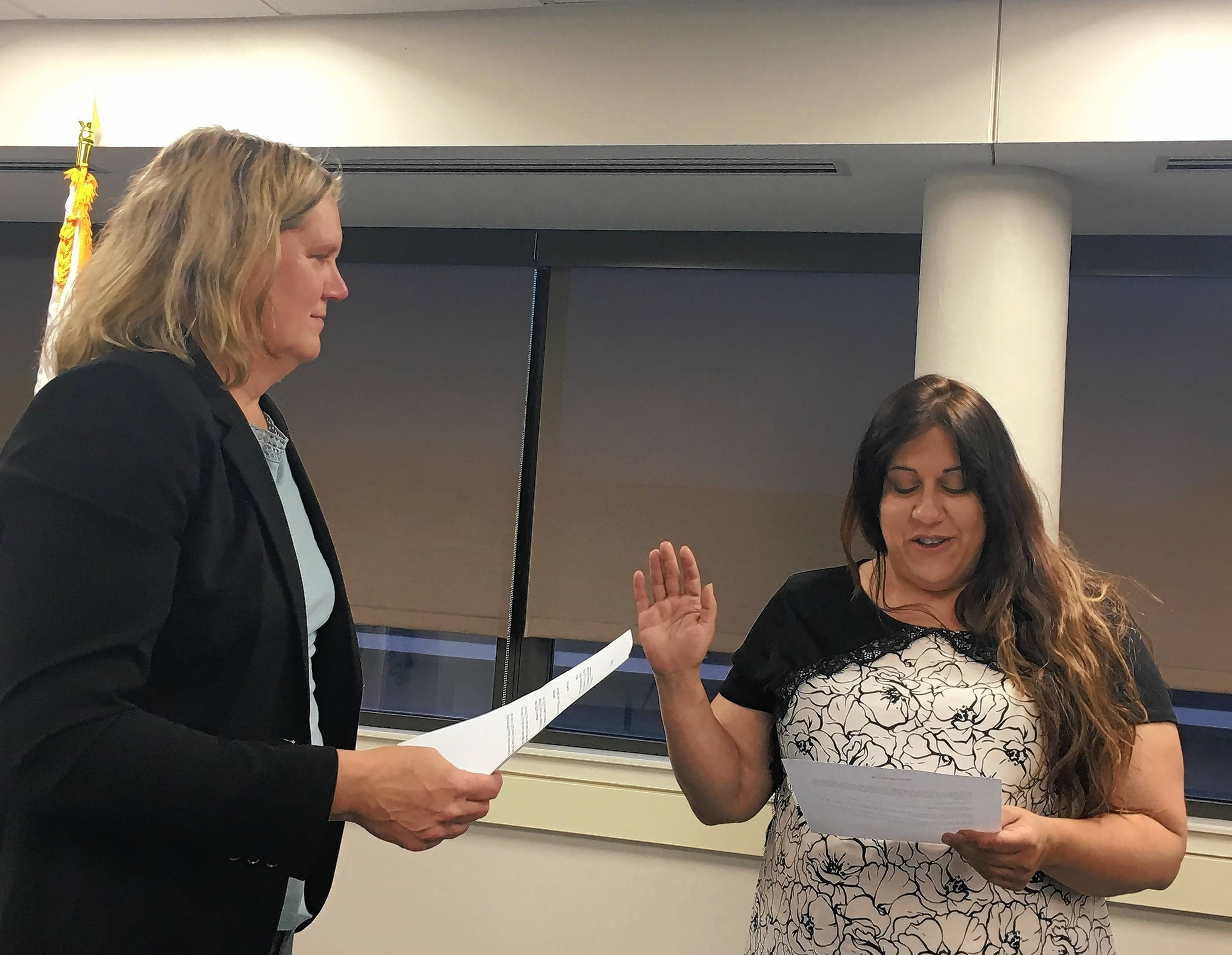 Des Plaines Elementary School District 62 Board President Stephanie Duckman administers the oath of office for appointee Tina Garrett.