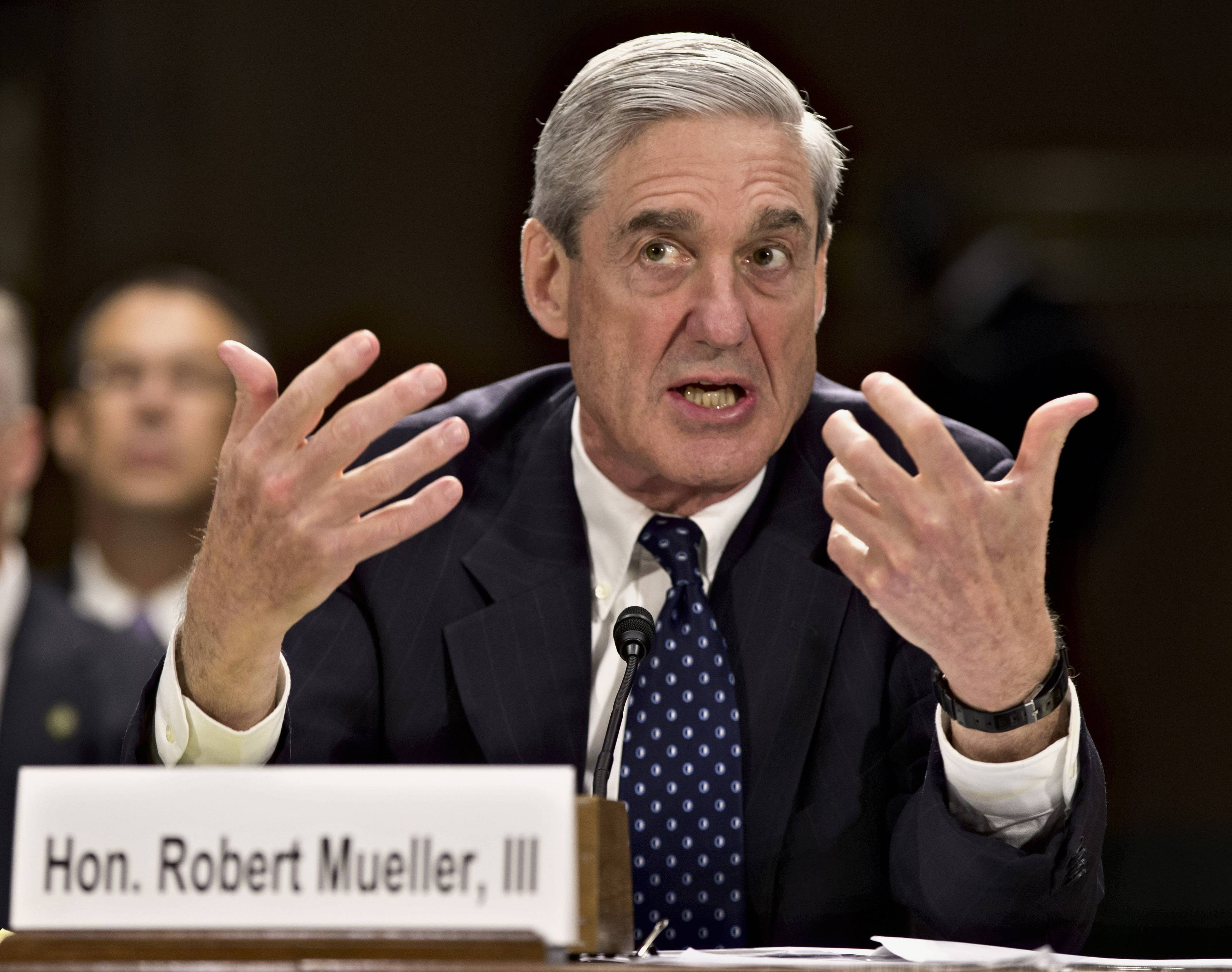 In this June 19, 2013, file photo, former FBI Director Robert Mueller testifies on Capitol Hill in Washington. The Justice Department said it is appointing Mueller as special counsel to oversee investigation into Russian interference in the 2016 presidential election.