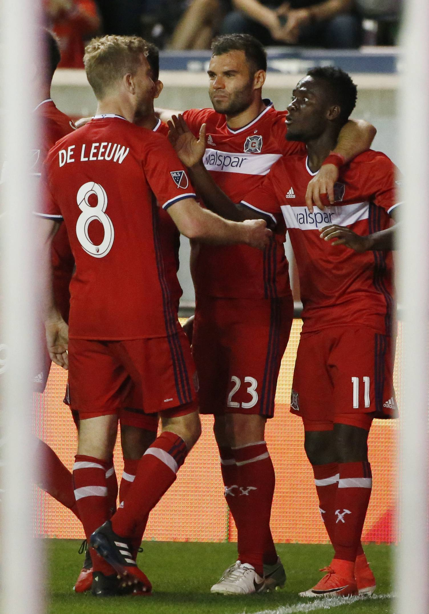 Chicago Fire midfielder David Accam (11) celebrates with forwards Nemanja Nikolic (23) and Michael de Leeuw (8) after scoring a goal against the Colorado Rapids during the second half of an MLS soccer match, Wednesday, May 17, 2017, in Bridgeview, Ill. (AP Photo/Nam Y. Huh)