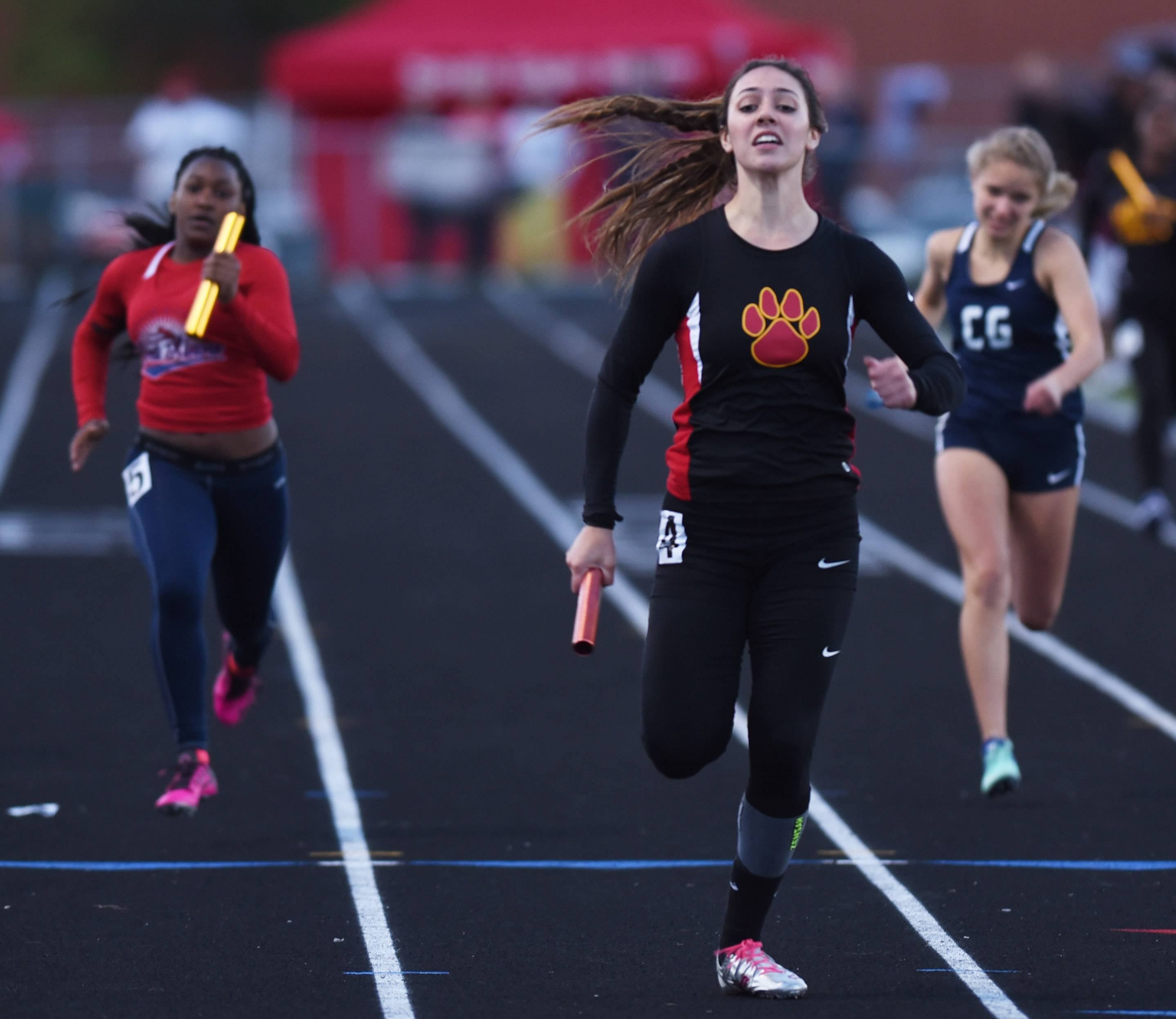 Batavia's Tori Ortiz crosses the finish line in first place as the anchor leg of the 800-meter relay at the Class 3A Bartlett girls track and field sectional meet at Millennium Field in Streamwood last week. Batavia won the event and will compete at the state final meet in Charleston this weekend.