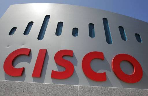 FILE - This Wednesday, May 9, 2012, file photo, shows an exterior view of Cisco Systems Inc. headquarters in Santa Clara, Calif. Cisco Systems Inc. reports earnings, Wednesday, May 17, 2017. (AP Photo/Paul Sakuma, File)