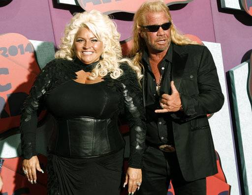 FILE - In this June 4, 2014 file photo, Beth Chapman, left, and Duane Chapman arrive at the CMT Music Awards at Bridgestone Arena, in Nashville, Tenn. Beth Chapman, the wife of bounty hunter reality TV star, Duane Chapman, won't have a role in helping select the next chief of the Honolulu Police Department. Commissioners decided at a meeting Wednesday, May 17, 2017, they are moving forward with the chief's selection process without creating the five-member panel. (Photo by Wade Payne/Invision/AP, File)
