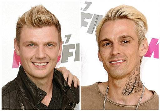 "FILE - In this combination photo, Nick Carter, left, of the Backstreet Boys and his singer brother Aaron Carter appear at Wango Tango on May 13, 2017, in Carson, Calif. Robert Carter, the father of Nick and Aaron Carter, died Tuesday, May 16, 2017. Nick Carter said in a statement Wednesday that he was ""heartbroken to share the news that our father, Robert, passed away last night.� Aaron Carter, 29, posted a photo of his dad on Instagram on Wednesday. (Photo by Richard Shotwell/Invision/AP, File)"
