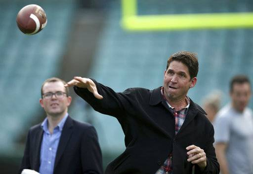 Three-time Super Bowl champion Ed McCaffrey throws a ball during a promotion for the Sydney Cup in Sydney, Australia, Thursday, May 18, 2017. Stanford University and Rice will play the opening game of the college football season in Sydney on Aug. 27. (AP Photo/Rick Rycroft)
