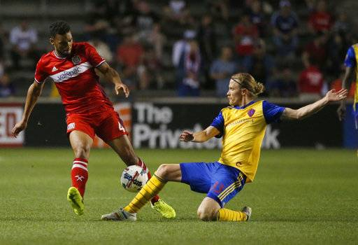 Colorado Rapids defender Jared Watts, right, tackles Chicago Fire defender Johan Kappelhof during the second half of an MLS soccer match, Wednesday, May 17, 2017, in Bridgeview, Ill. The Fire won 3-0. (AP Photo/Nam Y. Huh)