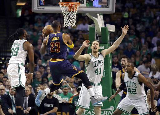 Cleveland Cavaliers forward LeBron James (23) drives against Boston Celtics' Jae Crowder (99), Kelly Olynyk (41) and center Al Horford (42) during the first quarter of Game 1 of the NBA basketball Eastern Conference finals, Wednesday, May 17, 2017, in Boston. (AP Photo/Charles Krupa)