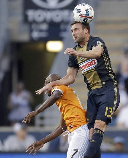 Philadelphia Union forward Chris Pontius, right, heads the ball over Houston Dynamo midfielder DaMarcus Beasley during the first half of an MLS soccer match Wednesday, May 17, 2017, in Chester, Pa. (Yong Kim/The Philadelphia Inquirer via AP)