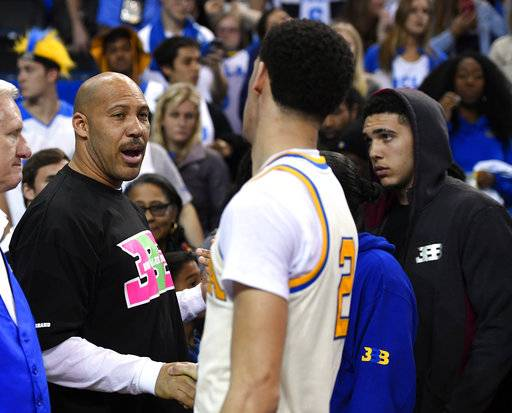 "FILE - In this March 4, 2017, file photo, UCLA guard Lonzo Ball, right, shakes hands with his father LaVar following an NCAA college basketball game against Washington State in Los Angeles. The outspoken father of former UCLA star Lonzo Ball said Wednesday, May 17, on Fox Sport 1's ""The Herd with Colin Cowherd"" that it will now cost a shoe company $3 billion to make a deal with his Big Baller Brand. (AP Photo/Mark J. Terrill, File)"