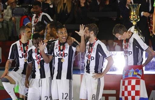 Juventus' Alex Sandro and teammates celebrate after winning the Italian Cup soccer final match between Lazio and Juventus, at Rome's Olympic stadium, Wednesday, May 17, 2017. Juventus won 2-0. (AP Photo/Gregorio Borgia)