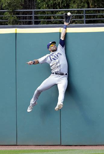 Tampa Bay Rays' Kevin Kiermaier jumps to catch a fly ball hit by Cleveland Indians' Jason Kipnis for the last out in the ninth inning of a baseball game, Wednesday, May 17, 2017, in Cleveland. The Rays won 7-4. (AP Photo/Tony Dejak)