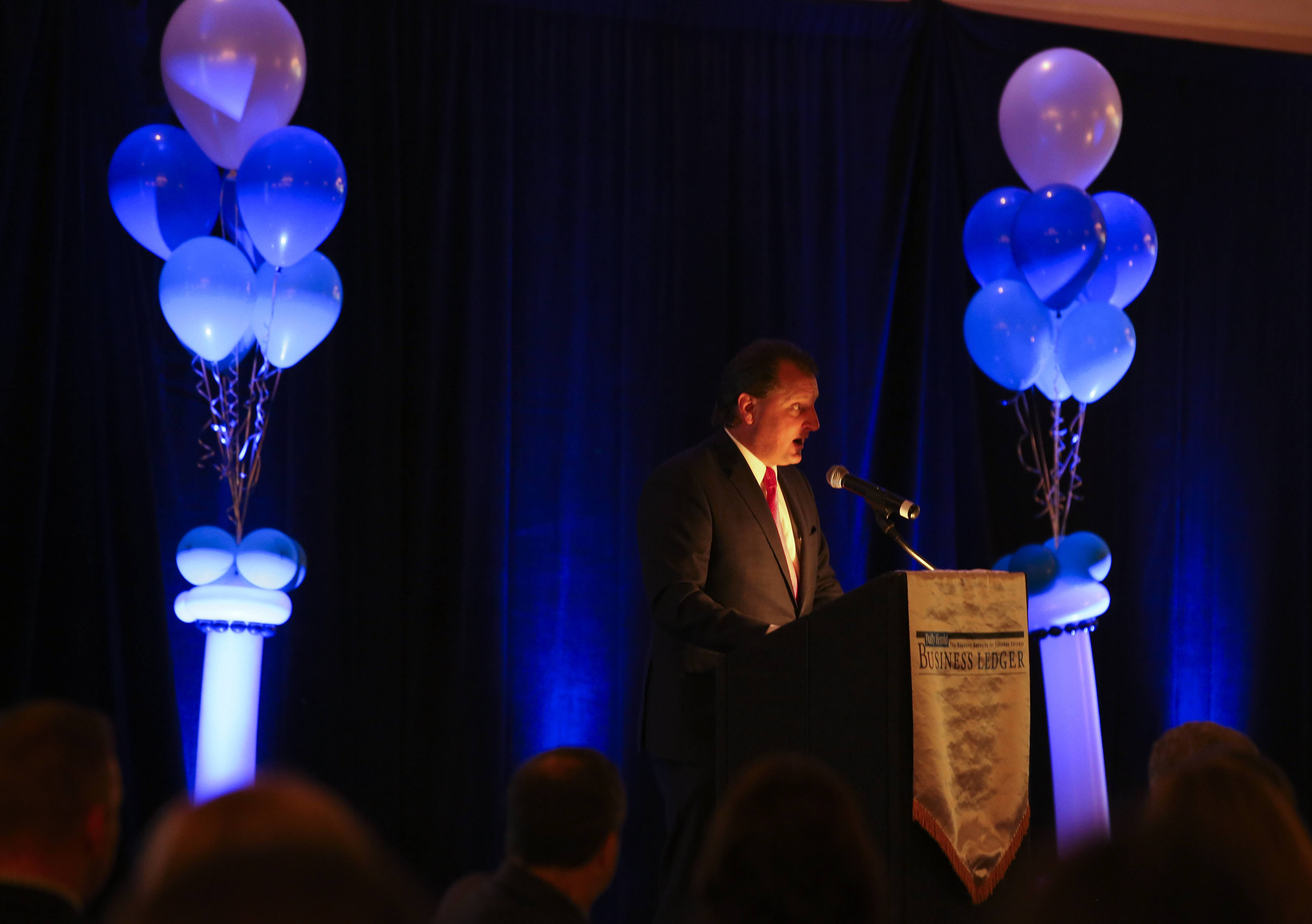 Bev Horne/bhorne@dailyherald.com Peter Burke, president of Best Companies Group, gives a talk at the Best Places to Work in Illinois ceremony at Abbington Banquets in Glen Ellyn.