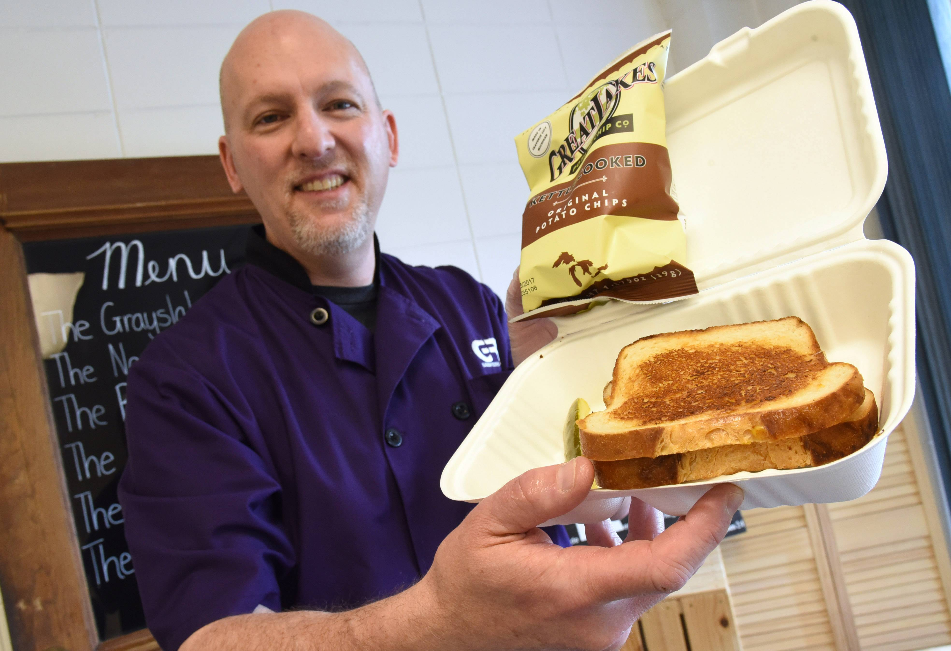 Paul Patricelli with The Grayslaker at his new carryout grilled cheese restaurant, GRIL, in Mundelein.