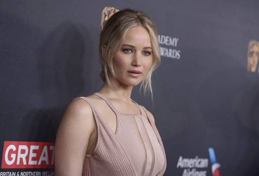 FILE - In this Oct. 28, 2016, file photo, Jennifer Lawrence arrives at the BAFTA Los Angeles Britannia Awards at the Beverly Hilton Hotel in Beverly Hills, Calif. Lawrence acknowledged on May 17, 2017, that a tabloid site's video of her dancing on a stripper pole is the real thing, but the actress says she's not sorry about it. (Photo by Richard Shotwell/Invision/AP, File)