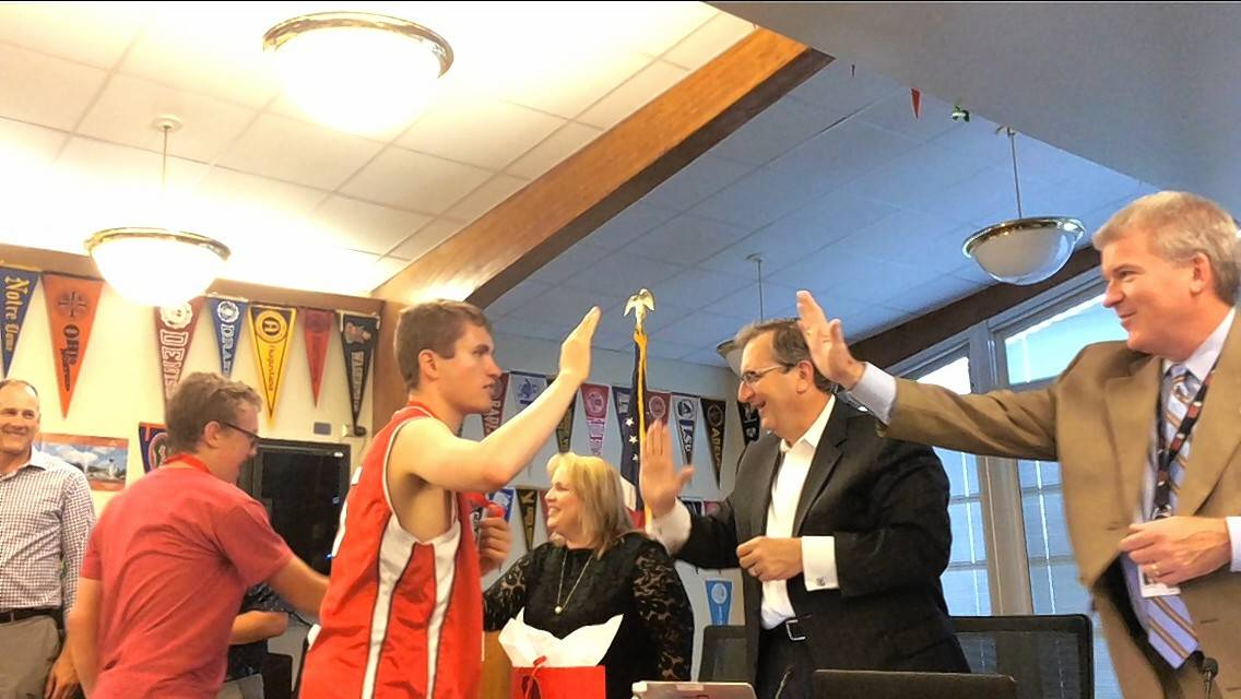 Barrington High School's Special Olympics basketball team is celebrating a second consecutive state title. The team was recognized at this week's Barrington Area Unit School District 220 board meeting. Congratulating the players from right to left are Superintendent Brian Harris, board President Brian Battle and board member Penny Kazmier.