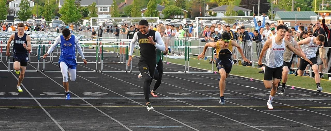 Fremd's Jaden Jackson and Barrington's Ross Bravo get to the finish first in the 110-meter high hurdles in Thursday's sectional meet at Fremd.
