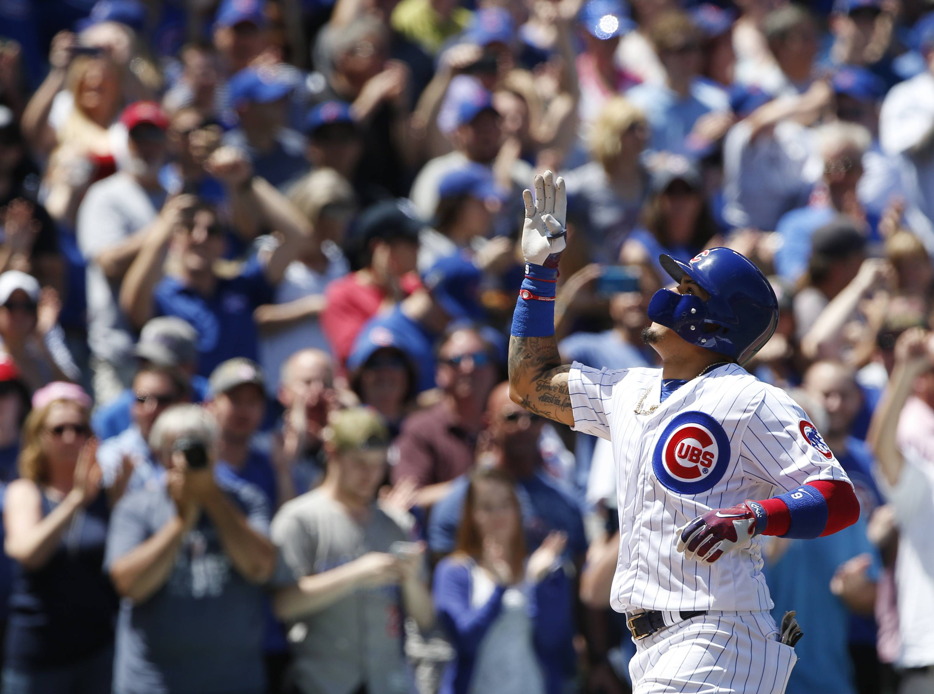 Chicago Cubs' Javier Baez celebrates after hitting a grand slam during the first inning of a baseball game against the Cincinnati Reds in Chicago, Thursday, May 18, 2017.
