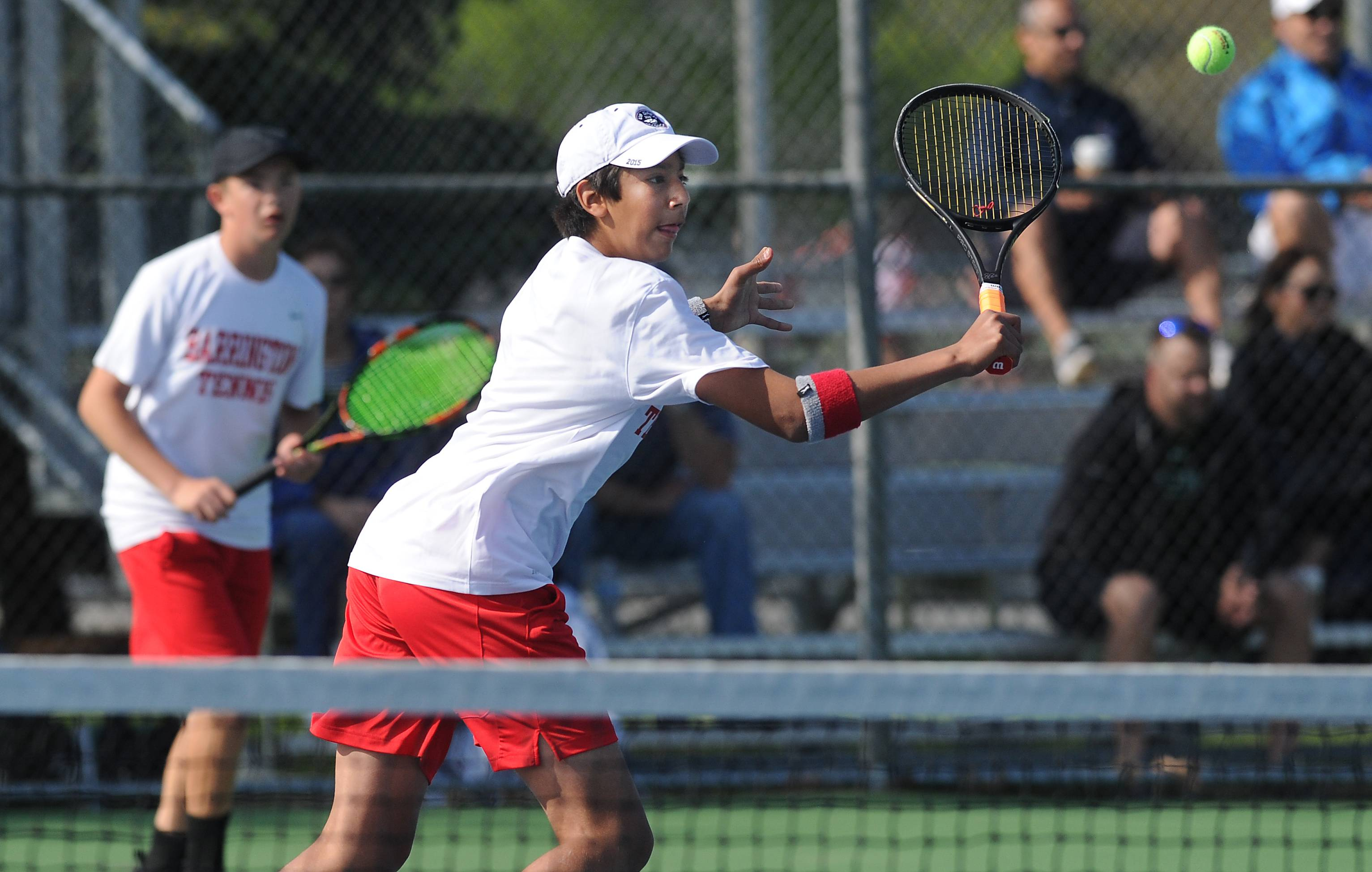 Barrington's Aryan Sharma, here returning a shot alongside partner Matthew D'Amore, compete with the teammates in a tough Cary-Grove sectional this weekend.