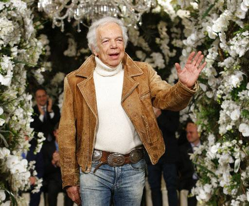 FILE - In this Wednesday, Feb. 15, 2017, file photo, designer Ralph Lauren waves to the applause of attendees after his Fall 2017 collection was modeled at the clothier's flagship store in New York. Ralph Lauren Corp. reports earnings, Thursday, May 18, 2017. (AP Photo/Kathy Willens, File)