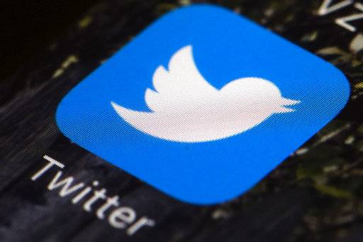 This Wednesday, April 26, 2017, photo shows the Twitter icon on a mobile phone, in Philadelphia. On Thursday, May 18, 2017, Twitter announced that it is updating its privacy policy so it can track users' interests better and target advertisements to them, at least in the United States. Along with this, Twitter is also rolling out more granular controls so users can decide, to an extent, whether and how they want to be tracked and targeted. The move comes as the company reels from its first quarterly revenue drop since going public. (AP Photo/Matt Rourke)