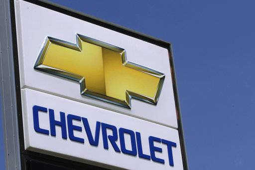 FILE - In this July 8, 2012 file photo, the Chevrolet logo is seen at an auto dealership in Springfield, Ill. General Motors Co. is pulling its Chevrolet brand out of India, South Africa and East Africa by the end of 2017. The company will retain its assembly plant in India but will only make vehicles for export. It is selling a plant in South Africa to Isuzu Motors. (AP Photo/Seth Perlman)
